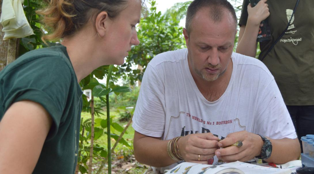 Stuart Timson helping a Conservation volunteer with one of her daily tasks